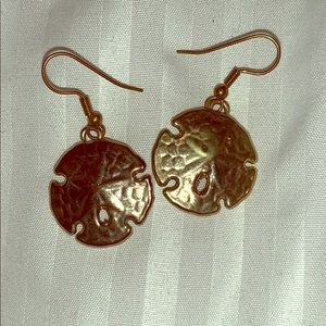 Gold sand dollar dangling earrings